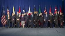 Trans-Pacific Partnership leaders pose for a photo prior to a meeting on the sidelines of the Asia-Pacific Economic Cooperation (APEC) Summit in Manila on November 18, 2015. (SAUL LOEB/AFP/Getty Images)