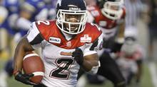 Calgary Stampeders' Larry Taylor runs the ball against the Winnipeg Blue Bombers during the second half of CFL action in Winnipeg Thursday, July 14, 2011. (Trevor Hagan/THE CANADIAN PRESS)