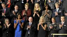First lady Michelle Obama and guests applaud during President Barack Obama's State of the Union address on Capitol Hill in Washington, Tuesday, Jan. 24, 2012. Front row, from left are, Jackie Bray, Obama, retired Capt. Mark Kelly, Jill Biden, Sgt. Ashleigh Berg, Hiroyuki Fujita, Richard Cordray, and Sara Ferguson. Second row, from left are, Eric Schneiderman, Juan Jose Redin, Debbie Bosanek, Laurene Powell Jobs, Alicia Boler-Davis, and Col. Ginger Wallace. (AP Photo/Susan Walsh) (Susan Walsh/AP)