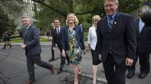 Christine Elliott, centre, walks across University Avenue toward Queen's Park with supporters after announcing her intention to run for the Ontario PC leadership during a press conference in Toronto on Wednesday, June 25, 2014. (DARREN CALABRESE/THE CANADIAN PRESS)