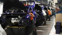 Employees work on the assembly line of the new Ford Fiesta in Cologne in a Feb. 4, 2013 file photo. European car sales fell to a 17-year low in 2012 and are expected to drop further this year. (WOLFGANG RATTAY/REUTERS)