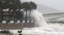 A huge wave caused by Typhoon Sarika hits a dike in Sanya, south China on Tuesday, Oct. 18, 2016. Typhoon Sarika is being followed closely by Typhoon Haima , expected to hit the Philippines Wednesday. (STR/AFP/Getty Images)