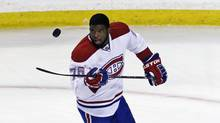 Montreal Canadiens defenceman P.K. Subban flips the puck prior to facing the Boston Bruins in Game 2 in the second-round of a Stanley Cup hockey playoff series in Boston, Saturday, May 3, 2014. (Charles Krupa/AP)