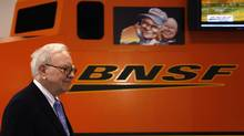 Berkshire Hathaway chairman Warren Buffett walks by a mock BNSF railroad engine at the Berkshire Hathaway annual meeting in Omaha in this May 1, 2010 file photo. Mr. Buffett often talks about how no one knows what's going to happen with the economy or market in the short term. 'We've long felt that the only value of stock forecasters is to make fortune tellers look good,' Mr. Buffett once wrote in a Berkshire Hathaway annual letter. (RICK WILKING/REUTERS)