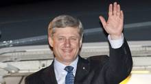 Prime Minister Stephen Harper waves as he arrives in London, Thursday June 3, 2010. Harper is on a two day trip to the United Kingdom and France ahead of this months G8 and G20 meetings in Canada. (Adrian Wyld/Adrian Wyld/The Canadian Press)