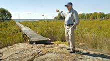 Bill Ives of Waubaushene, Ont., walks along a dock on his waterfront property in 2007. The water levels in Georgian Bay have receded leaving waterfront properties literally high and dry. (Kevin Van Paassen/Kevin Van Paassen/The Globe and Mail)