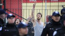 G20 Summit protesters flash peace signs as they are released from the temporary detention centre on Eastern Ave. in Toronto, Ont on June 27/2010. (Kevin Van Paassen/Kevin Van Paassen/The Globe and Mail)