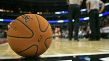 A ball sits on the court during a timeout at an NBA basketball game in Chicago on Monday, Dec. 11, 2006. (Brian Kersey/AP)
