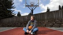 Paul Stauskas, 53, poses for a portrait at a backyard basketball court he built for his sons at his home in Mississauga. His son Nik (not pictured) plays for The University of Michigan Wolverines men's basketball team.  (Philip Cheung)