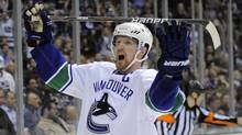 Vancouver Canucks centre Henrik Sedin of Sweden celebrates his goal during the third period of Game 4 in a first-round NHL Stanley Cup playoff series against the Los Angeles Kings, Wednesday, April 18, 2012, in Los Angeles. (Associated Press)