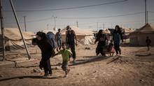Syrian refugees carry their belongings to their tent after arriving at the Zaatari refugee camp in Jordan, in this handout photo taken on September 3, 2012. The AP reported last month that scores of women in the camp had either turned to or have been forced into prostitution. (HANDOUT/REUTERS)