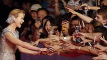 In this Saturday June 14, 2014 photo, Nicole Kidman, left, shakes hands of fans as she attends the opening ceremony of the 17th Shanghai International Film Festival in Shanghai, China. (AP)