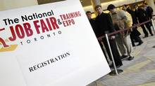 Dozens lin up to register for the The National Job Fair & Training Expo at the Metro Toronto Convention Centre, 2012. (J.P. MOCZULSKI For The Globe and Mail)
