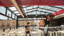 With its bright red support beams and exposed bolts, the retractable patio roof at Gusto 101 adds to the industrial feel of the restaurant space that was formerly a Toronto garage at 101 Portland Street. Designed and built by Oakville-based OpenAire Inc., the glass roof is nearly 10 metres wide and 16 metres long when closed. (Jennifer Roberts for The Globe and Mail)
