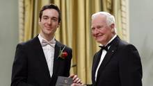 Jordan Tannahill is presented the Governor General's Literary Award for drama by Governor General David Johnston during a ceremony at Rideau Hall in Ottawa, Wednesday, November 26, 2014. (Patrick Doyle/The Canadian Press)