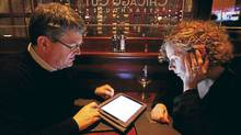 Keith and Peg Bragg find Chicago Cut?s iPad wine list helps them navigate the restaurant?s 750-plus bottles. (Charles Rex Arbogast/Associated Press/Charles Rex Arbogast/Associated Press)
