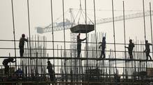 Labourers work on scaffolding at a residential construction site in Hefei, Anhui province, China, on March 6, 2012. (JIANAN YU/REUTERS/JIANAN YU/REUTERS)