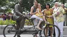 Jack Layton's daughter, Sarah, granddaughter Beatrice, widow Olivia Chow and city councillor Pam McConnell share a laugh as a statue in memory of Layton was unveiled in Toronto, Ontario Thursday, August 22, 2013. (Kevin Van Paassen/The Globe and Mail)