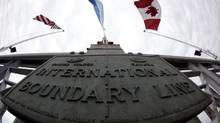 The International Boundary Line between the United States and Canada is shown on the Peace Bridge in Buffalo, N.Y. (David Duprey/AP)