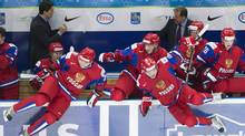 Russia teammates jump off their bench to celebrate after defeating Switzerland during a shoot out during quarter-final IIHF World Junior Championships hockey action inUfa, Russia on Wednesday, Jan. 2, 2013. (Reuters)