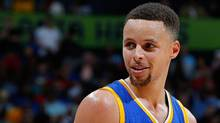 'I'm not going to tell you what I shot, but that was a bucket-list kind of day. I'm a golf fanatic, so to say I played at Augusta is pretty cool,' Golden State Warriors guard Stephen Curry said. (Kevin C. Cox/Getty Images)
