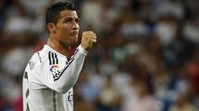 Real Madrid's Cristiano Ronaldo celebrates after scoring a goal against Cordoba during their Spanish first division soccer match at Santiago Bernabeu stadium in Madrid August 25, 2014. (SERGIO PEREZ/REUTERS)