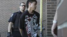 Adam Capay is brought into the Ontario Court of Justice on June 6, 2012. He has been held in solitary since then, and has never had a trial. (Jeff Labine/tbnewswatch.com)