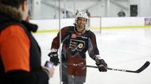 Maxime Talbot smiles at fans as he practices at the Philadelphia Flyers' NHL hockey training facility Monday, Jan. 7, 2013, in Voorhees, N.J. (Associated Press)