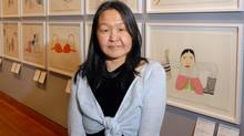 Annie Pootoogook is pictured with her work in an undated photo.