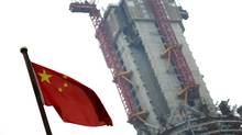 A Chinese national flag is seen near a construction site in Shanghai's financial district June 1, 2012. (Reuters)