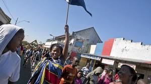 A girl marches with a South African flag in a parade during an Africa Day festival in Yeoville, an inner-city neighbourhood in Johannesburg.