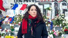 Dr. Louise Hefez, who was at Le Carillon bar on the night of the assault, stands near flowers and memorials at Place de la Republique in Paris. (Rachelle Simoneau for The Globe and Mail)