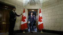 Canada's Prime Minister Justin Trudeau (C) and Finance Minister Bill Morneau (R) walk from Trudeau's office to the House of Commons to deliver the budget on Parliament Hill in Ottawa, Canada, March 22, 2016. (CHRIS WATTIE/REUTERS)