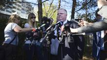 Toronto mayor Rob Ford speaks at a brief press scrum at a local gas station in Etobicoke to talk about the arrest of his friend and occasional driver, Alessandro Lisi. (Fred Lum/The Globe and Mail)