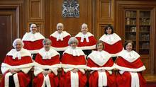 Canada's Supreme Court Justices pose for a photo at the Supreme Court of Canada in Ottawa Nov. 14, 2011. The Justices are (bottom row L - R) Morris Fish, Louis LeBel, Chief Justice Beverley McLachlin, Marie Deschamps, Rosalie Abella; (top row L - R) Michael Moldaver, Marshall Rothstein, Thomas Cromwell and Andromache Karakatsanis. (BLAIR GABLE/BLAIR GABLE/REUTERS)