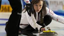 Canada's skip Rachel Homan delivers a stone against China (Andrew Vaughan/The Canadian Press)