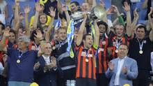 Dario Srna of Shakhtar Donetsk lifts up Ukraine's soccer Super Cup after their victory against Dynamo Kiev at Lviv Arena in Lviv, Ukraine, Tuesday, July 22, 2014. (Associated Press)