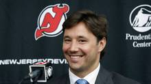 New Jersey Devils star forward Ilya Kovalchuk, of Russia, smiles during a news conference in Newark, N.J., Tuesday, July 20, 2010. (Mel Evans/AP)