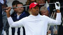 U.S. golfer Tiger Woods reacts to his tee shot on the 13th hole during the morning foursomes round at the 39th Ryder Cup matches at the Medinah Country Club in Medinah, Illinois September 28, 2012. (MIKE BLAKE/REUTERS)