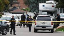Police stand at a crime scene in front of a house where three pople died in an incident involving a crossbow in the Scarborough suburb of Toronto on August 25, 2016. (MARK BLINCH/REUTERS)