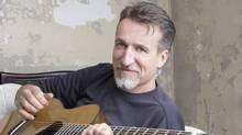Singer-songwriter Steve Bell with Guitar