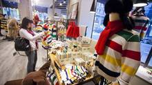 Shoppers browse through the Hudson's Bay Company's custom brand products at their flagship store in downtown Toronto, Ontario Saturday Dec. 8, 2012 (Tim Fraser For The Globe and Mail)