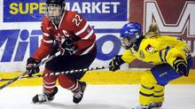 Hayley Wickenheiser of Canada, left, and Frida Nevalainen of Sweden in action during the women's ice-hockey Four Nations tournament in Vantaa, Finland Friday Nov 9, 2012. (Mikko Stig/AP)