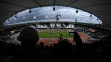 Athletes take part in the British Universities and Colleges Sport Athletics Championship at the Olympic Stadium in the Olympic Park in London, Saturday. (Matt Dunham)
