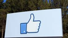 "A giant ""like"" icon made popular by Facebook is seen at the company's new headquarters in Menlo Park, Calif. in this Jan. 11, 2012 file photo. (© Robert Galbraith / Reuters/Robert Galbraith/Reuters)"
