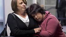 Nichelle Benn, right, and her mother Brenda Hardiman wait at provincial court in Dartmouth, N.S. on Wednesday, Jan. 15, 2014. Benn is facing charges after an incident at the rehabilitation facility where she lives. Hardiman says her daughter has cerebral palsy, epilepsy and an organic brain disorder that causes periodic episodes of aggressive behaviour. (Andrew Vaughan/THE CANADIAN PRESS)