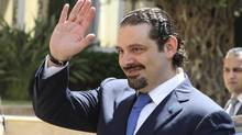Former Lebanese prime minister Saad al-Hariri gestures upon his arrival at the government's headquarters in Beirut on Aug. 8, 2014. (HANDOUT/REUTERS)