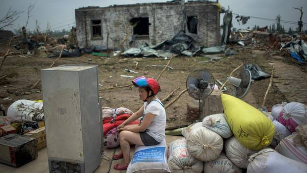 A resident sits in front of a destroyed house after a tornado in Funing, in Yancheng, in China's Jiangsu province on June 24, 2016. Survivors scrabbled through the rubble of their homes on June 24 after hurricane-force winds and a tornado left at least 98 dead in China, with hundreds more injured. (JOHANNES EISELE/AFP/Getty Images)