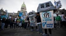 Government supporters demonstrated in front of the Congress in Buenos Aires earlier this month as lawmakers debated seizing control of Repsol's stake in YPF. (Natacha Pisarenko/Associated Press)