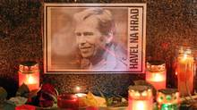 """A portrait of former Czech President Vaclav Havel, with a text that reads: """"Havel To The Castle,"""" a popular slogan during the Velvet Revolution of 1989, lies among candles left by mourners at the base of a statue of St. Wenceslas to commemorate Havel's death on December 18, 2011 in Prague, Czech Republic. (Sean Gallup/Getty Images/Sean Gallup/Getty Images)"""